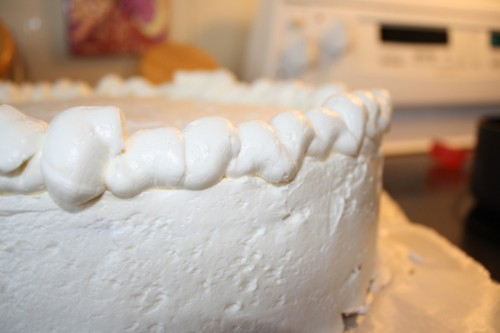 "A thick, wavy piping of buttercream helped form the ""crust"""