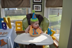 Birthday boy enjoying his first birthday