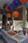 Treat table at alphabet flashcard themed first birthday party.